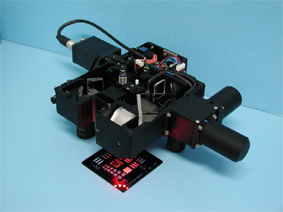 Dual magnification system with built-in illumination used for automatic inspection